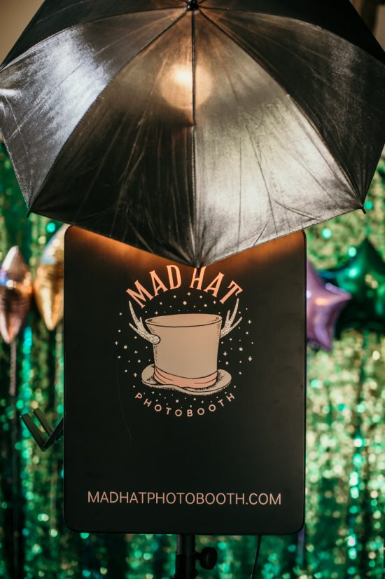 mad hat photo booth logo on black box for weddings and events