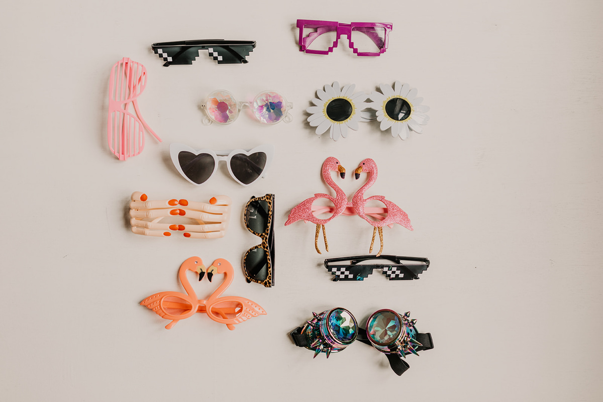 collection of glasses for photo booth props for any wedding or event
