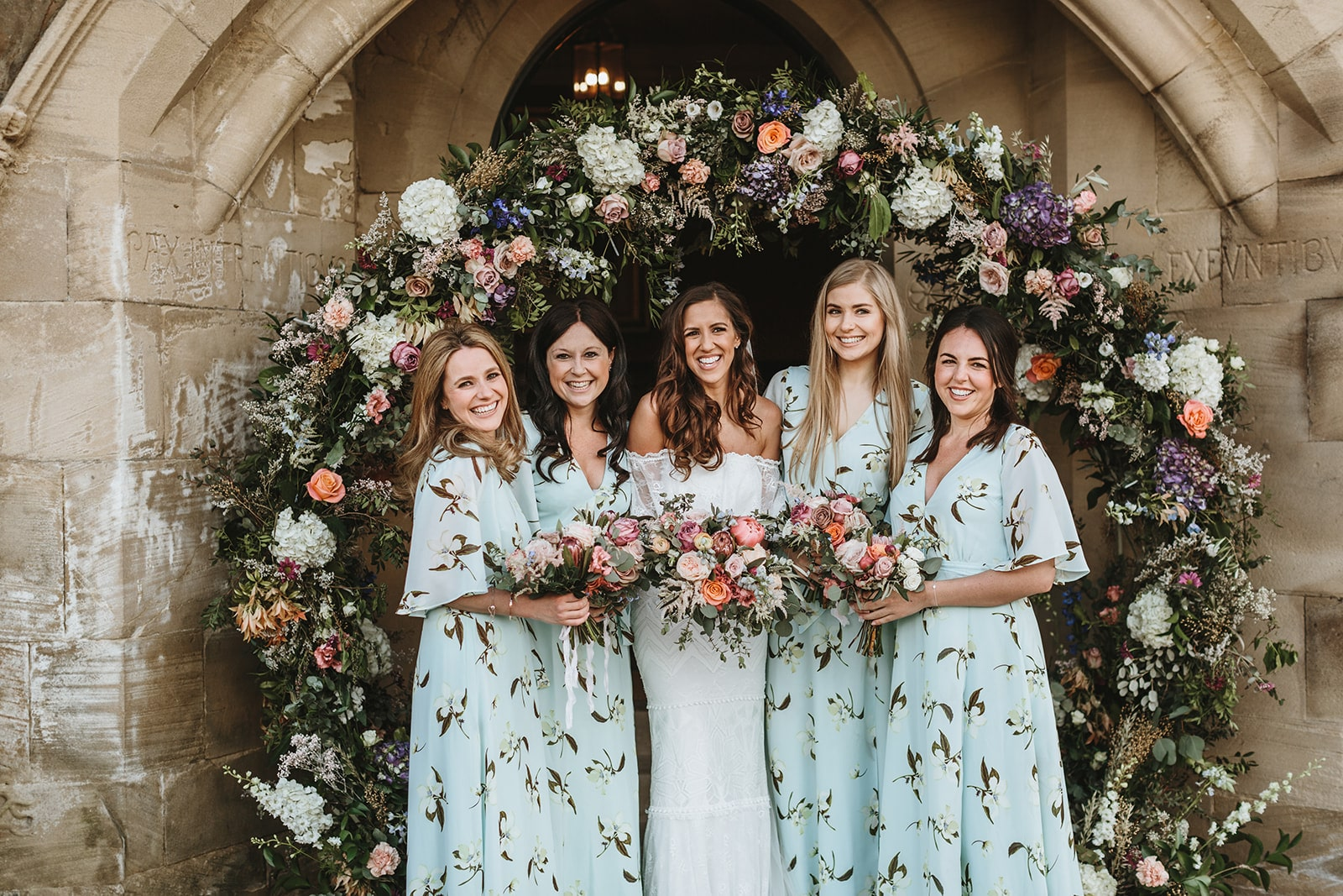 floral arch at a wedding for group shots