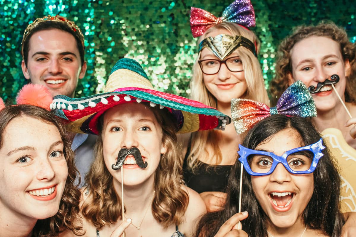 birthday party entertainment with green sequins back drop for a crazy fun photo booth