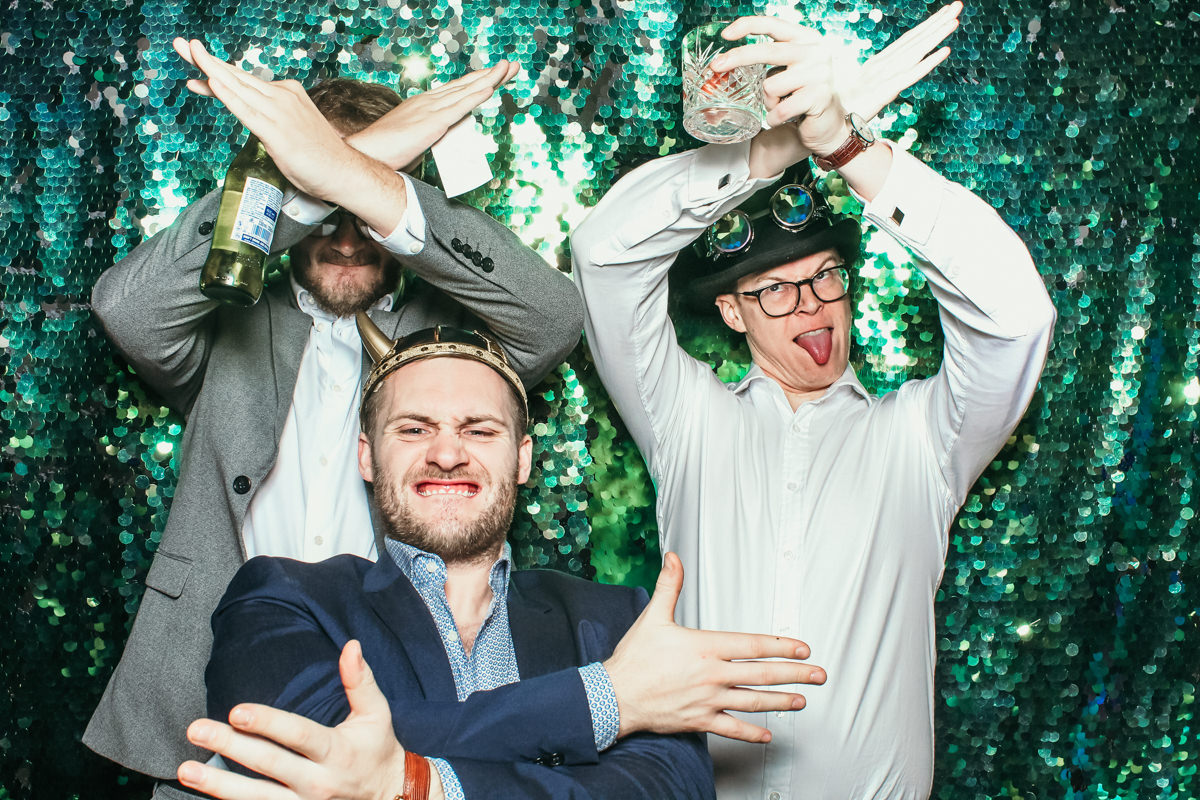 fun group of guys posing during an elmore court wedding photo booth hire