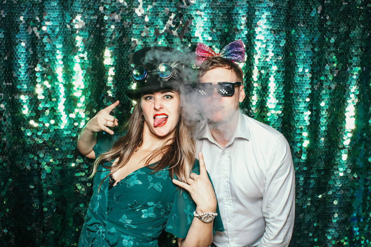 guy smoking during a photo booth pose at elmore court wedding venue in stroud