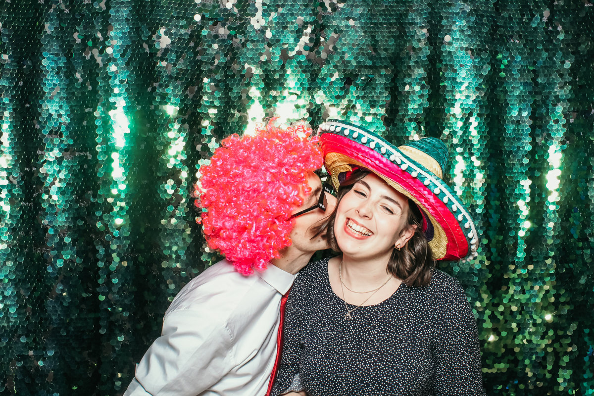 kiss in photo booth at elmore court weedding venue