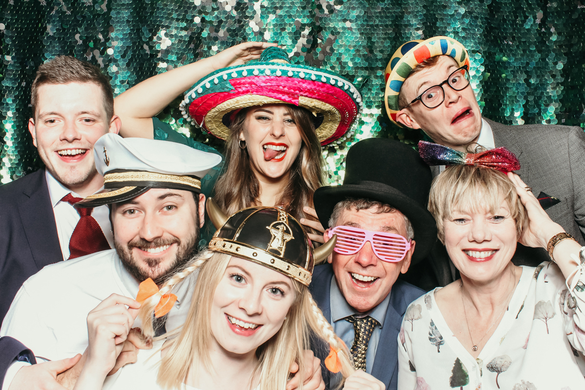 guests posing with sequins backdrop for cotswolds wedding photo booth , Mad hat photo booth