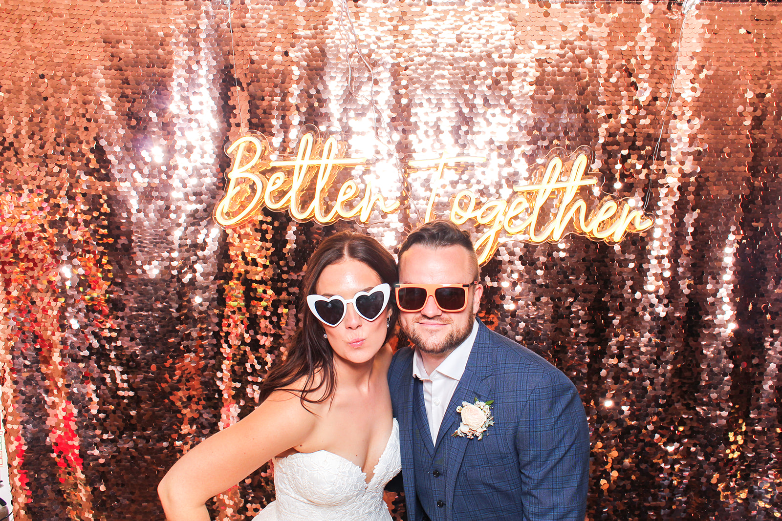 couple with wedding neon sign for a photo booth at Hyde House wedding venue