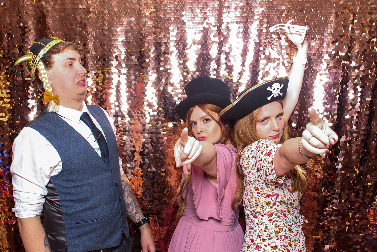 wedding guests posing for a photo booth at the great tythe barn in tetbury, cotswolds